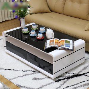 Bàn trà sofa 2 ngăn kéo đen giá rẻ tại Nội Thất Thiên Vương mang tới vẻ đẹp đẳng cấp và cực kỳ sang chảnh. Một không gian mới, một sức sống mới, vẻ đẹp sang trọng mà gia chủ nào cũng muốn có trong phòng khách hiện đại của gia đình mình.